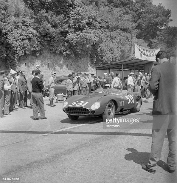 Spanish racing driver and sportsman Marquis Alfonso De Portago and codriver Eddy Nelson cruise past the Rome check point during the classic Italian...