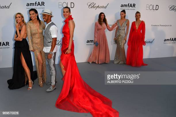 TOPSHOT Spanish racing driver Carmen Jorda Brazilian model Adriana Lima British Formula One driver Lewis Hamilton and Czech model Petra Nemcova...