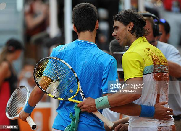 Spanish Rafael Nadal and Serbian Novak Djokovic congratulate each other after their semi final match of the ATP Madrid Open claycourt tournament...