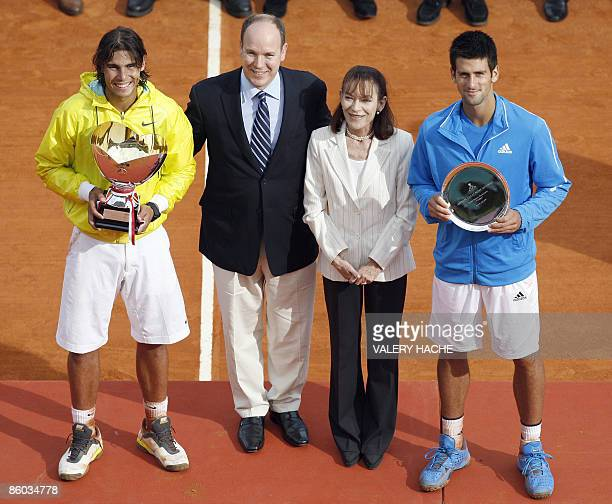 Spanish Rafael Nadal and Serbian Novak Djokovic pose with their trophy next Prince Albert II of Monaco and Princess ElisabethAnne De Massy at the end...