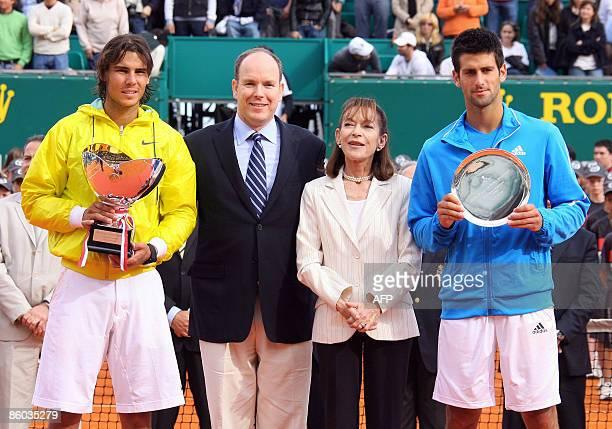 Spanish Rafael Nadal and Serbian Novak Djokovic pose with their trophy, next Prince Albert II of Monaco and Princess Elisabeth-Anne De Massy , at the...