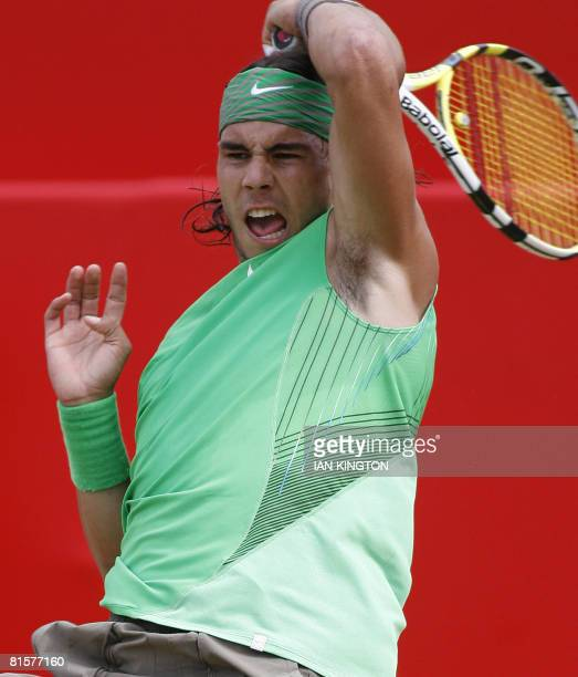 Spanish Rafael Nadal hits a forehand to Serbian Novak Djokovic during the Final on day 7 of the Artois Championship tennis tournament at Queen's Club...
