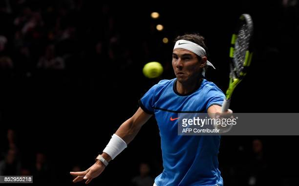 Spanish Rafael Nadal of Team Europe returns a ball to US John Isner of Team World during third day of Laver Cup on September 24 2017 in O2 Arena in...