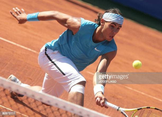 Spanish Rafael Nadal returns the ball to his German opponent Dennis Gremelmayr during their semifinals match in the Barcelona Open tennis tournament...