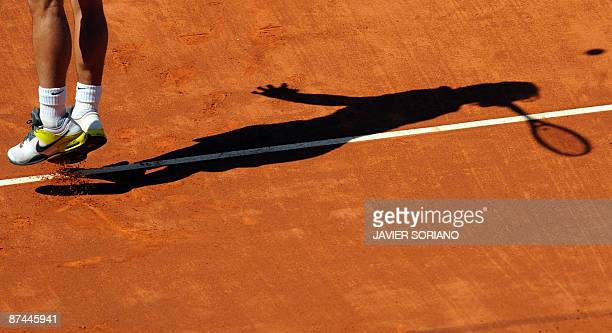 Spanish Rafael Nadal serves to Swiss Roger Federer during their final match of the ATP Madrid Open claycourt tournament on May 17 2009 in Madrid AFP...