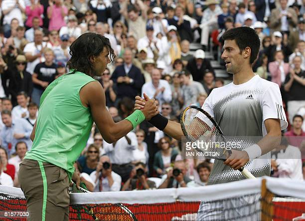 Spanish Rafael Nadal shakes hands with Serbian Novak Djokovic after winning the Final on day 7 of the Artois Championship tennis tournament at...