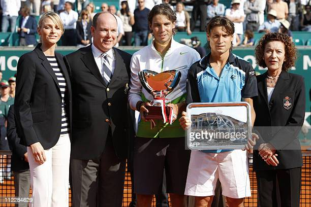 Spanish Rafael Nadal the winner of the MonteCarlo ATP Masters Series Tournament poses with his compatriot and opponent David Ferrer next to Prince...