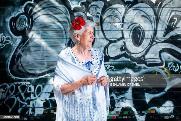 Spanish Rafaela dressed in traditional chulapa garb for San Isidro celebrations poses in Madrid on May 15 2018