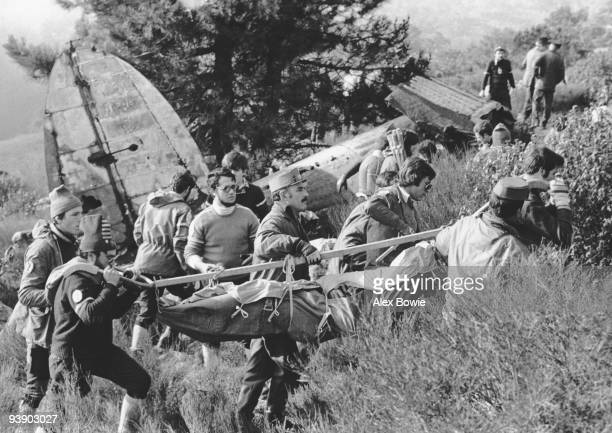 Spanish Red Cross workers aided by the Guardia Civil remove the body of a pilot from the wreckage of a Germanmade Heinkel He 111 E that served in the...