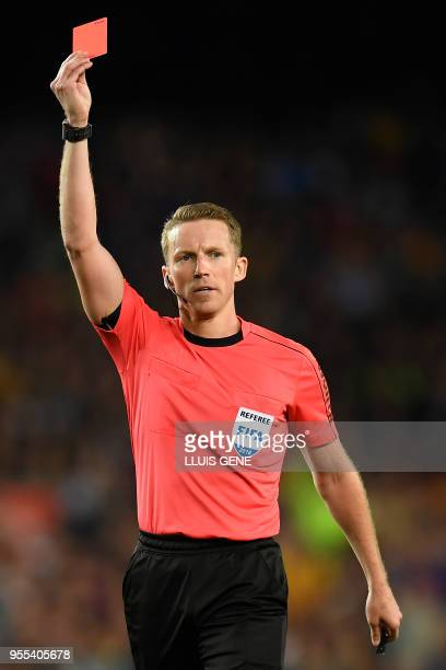 Spanish referee Alejandro Hernandez shows a red card to Barcelona's Spanish midfielder Sergi Roberto during the Spanish league football match between...