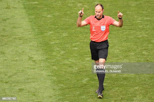 Spanish referee Antonio Mateu Lahoz asks for video assistance during the Russia 2018 World Cup Group C football match between Denmark and Australia...
