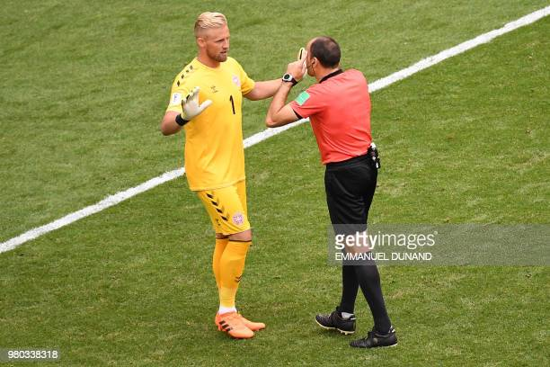 Spanish referee Antonio Mateu Lahoz speaks to Denmark's goalkeeper Kasper Schmeichel during the Russia 2018 World Cup Group C football match between...