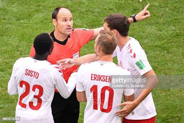 Spanish referee Antonio Mateu Lahoz speaks to Denmark's players during the Russia 2018 World Cup Group C football match between Denmark and Australia...