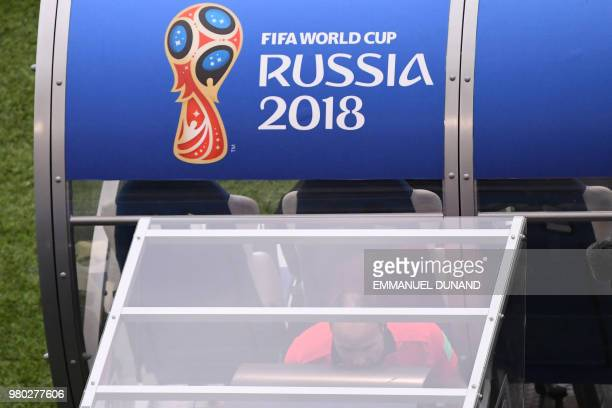 Spanish referee Antonio Mateu Lahoz watches a replay as he checks with the video assistant referee during the Russia 2018 World Cup Group C football...