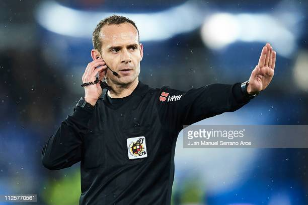 Spanish referee Melero Lopez checks with the VAR during the La Liga match between Deportivo Alaves and Rayo Vallecano de Madrid at Estadio de...