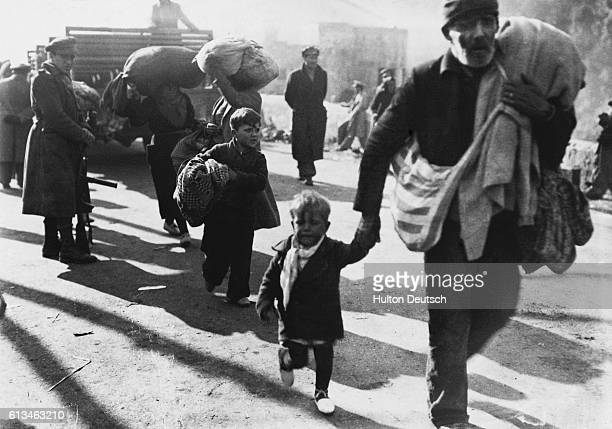 Spanish refugees made homeless by the civil war in Spain fill the road to Perpignan at Le Perthus in France