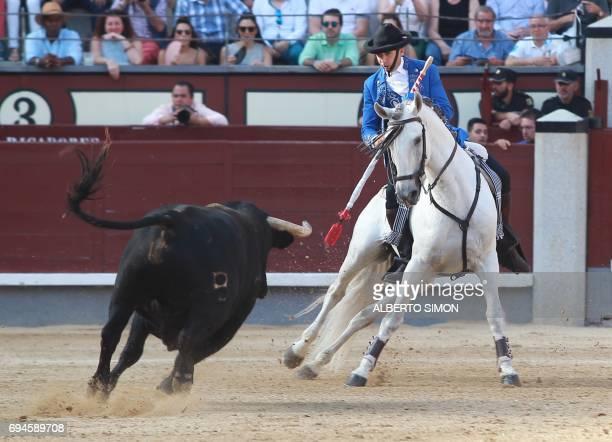 Spanish rejoneador Pablo Hermoso de Mendoza prepares to spear a bull during the San Isidro Feria at Las Ventas bullring in Madrid on June 10 2017 /...