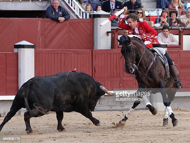 Spanish Rejoneo bullfighter on horseback Pablo Hermoso de Mendoza performs a pass on a bull during the San Isidro Feria at Las Ventas bullring in...