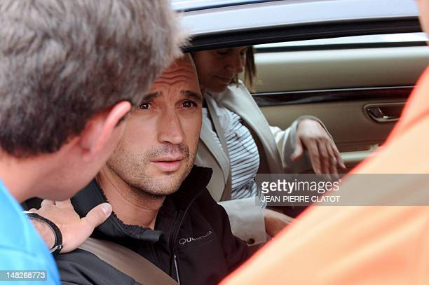 Spanish relatives of victims leave the hospital where bodies of victims are laid on July 13 2012 in Chamonix in the French Alps after an avalanche...