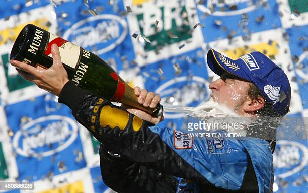 Spanish Renault driver Fernando Alonso celebrates on the podium of the Interlagos racetrack in Sao Paulo, 22 October 2006, after the Brazilian...