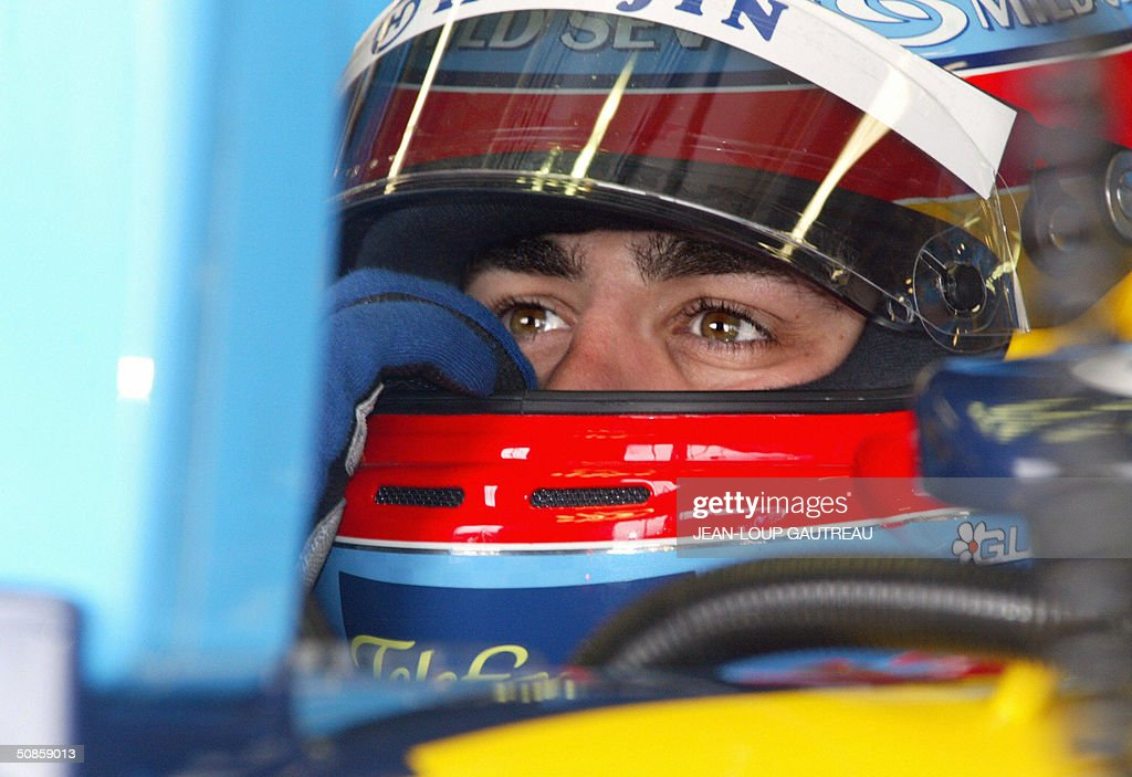 Spanish Renault driver Fernando Alonso sits in his car in the pits of the Monte-Carlo racetrack during the first free practice session three days before the Monaco Grand Prix, 20 May 2004 in Monaco.