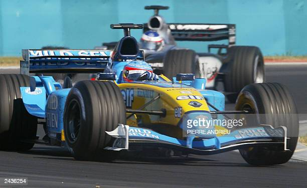 Spanish Renault driver Fernando Alonso steers his car ahead of McLaren-Mercedes driver Kimi Raikkonen on the Hungaroring racetrack near Budapest, 24...