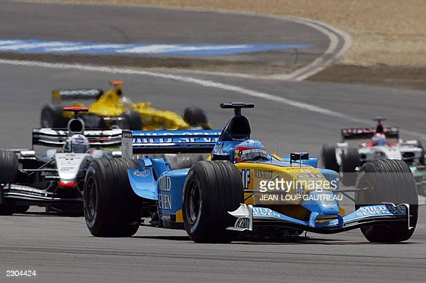 Spanish Renault driver Fernando Alonso steers his car ahead of Scottish McLarenMercedes driver David Coulthard on the Nurburgring racetrack 29 June...