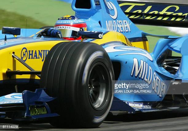 Spanish Renault driver Fernando Alonso steers his car on the Hockenheim racetrack during the German Grand Prix, 25 July 2004 in Hockenheim, Germany....