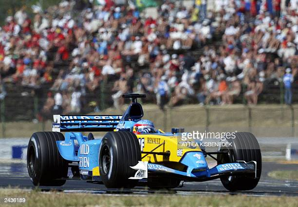 Spanish Renault driver Fernando Alonso steers his car on the Hungaroring racetrack near Budapest 24 August 2003 during the Hungarian Formula One...