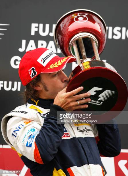 Spanish Renault Formula One driver Fernando Alonso on the winners podium celebrates winning the 2008 Japanese Grand Prix at the Fuji Speedway, Japan,...