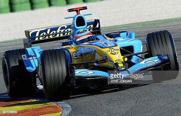 Spanish Renault Formula one driver Fernando Alonso takes a bend during a training session at Ricardo Tormo racetrack in Cheste,Valencia 03 February...