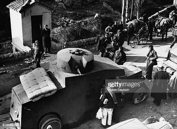 A Spanish Republican tank arrives at Le Perthus as the nationalists force their retreat over the border into France