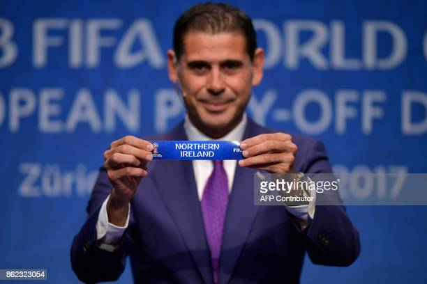 Spanish retired footballer Fernando Hierro shows the name of 'Northern Ireland' football team during the FIFA football World Cup 2018 European...