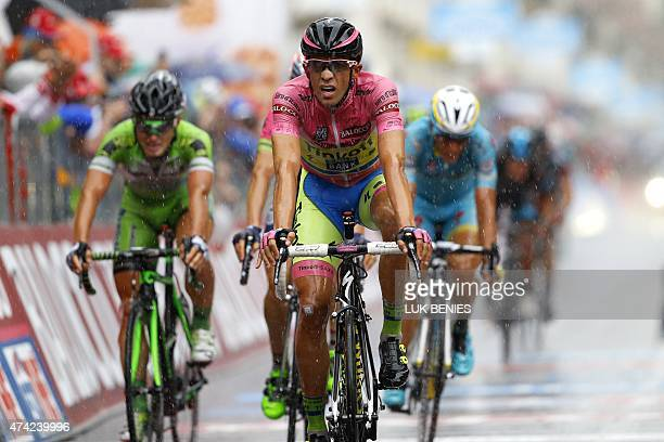 Spanish rider Alberto Contador crosses the finish line under heavy rain to place 2nd of the 12th stage of the 98th Giro d'Italia Tour of Italy...