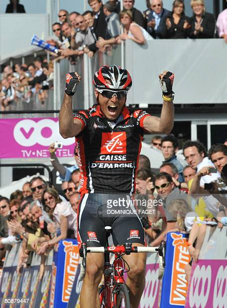 Spanish rider Alejandro Valverde jubilates as he crosses the finish line in Ans to win the classic LiegeBastogneLiege cycling race between Liege and...