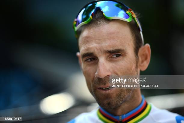Spanish rider Alejandro Valverde speaks after a training session of Spain's Movistar Team cycling team near Brussels on July 5 on the eve of the...