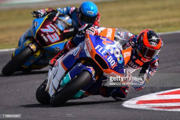 Spanish rider Augusto Fernandez , followed by EG 0,0 Marc VDS Spanish rider, Alex Marquez, competes on his way to win the San Marino Moto2 Grand Prix...