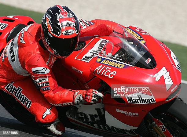 Spanish rider Carlos Checa of Ducati speeds during a free practice session of Qatar Grand Prix World Championships in Doha 29 September 2005 Qatar...