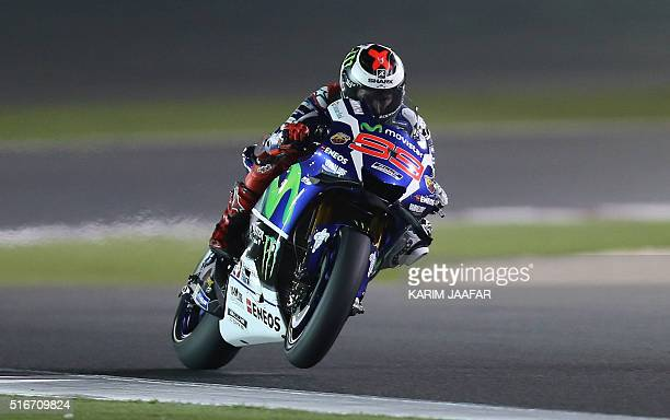 Spanish rider Jorge Lorenzo of Movistar Yamaha MotoGP competes during the MotoGP race of the Qatar Grand Prix on March 20 2016 at the Losail...