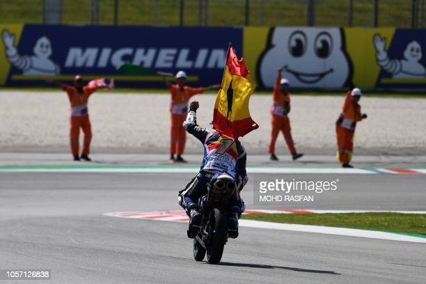 Spanish rider Jorge Martin celebrates after winning the Moto3 race of the Malaysia MotoGP at the Sepang International Circuit in Sepang on November...