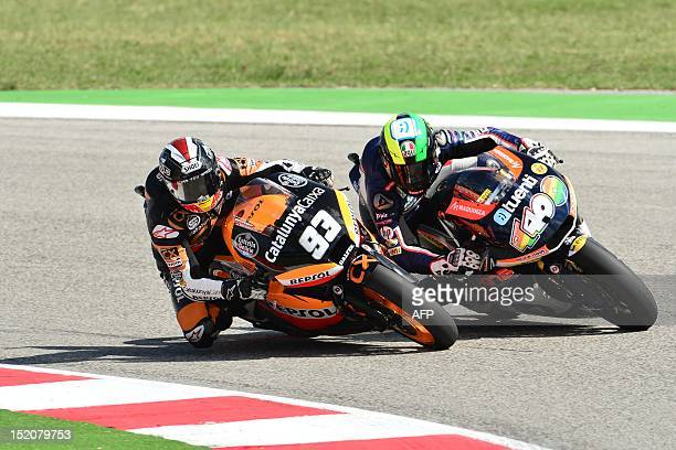Spanish rider Marc Marquez of Catalunya Caixa Repsol team and Spanish rider Pol Espargaro of Pons 40 hp team compete during the Moto 2 race of the...