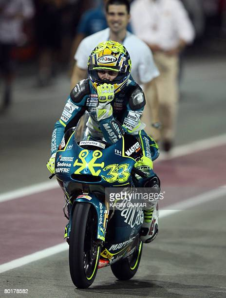 Spanish rider Sergio Gadea celebrates at the end of the 125cc race at the Qatar Grand Prix in Doha on March 9 2008 Gadea on an Aprilia won the 125cc...