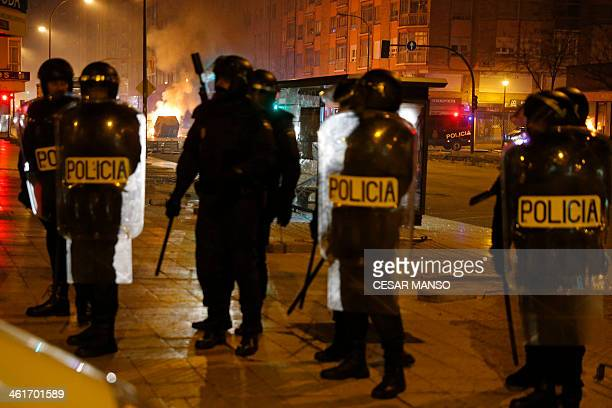 Spanish riot police at the end of clashes with demonstrators protesting against imminent construction works to revamp Vitoria street the city's main...