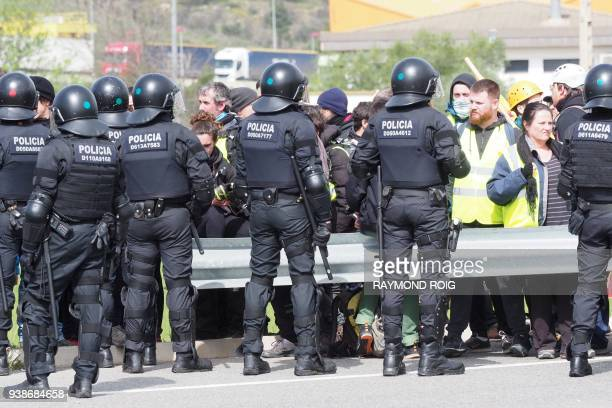 Spanish riot police faces a blockade by Catalan separatists on AP7 motorway linking Spain to neighbouring France near Figueras on March 27 2018...