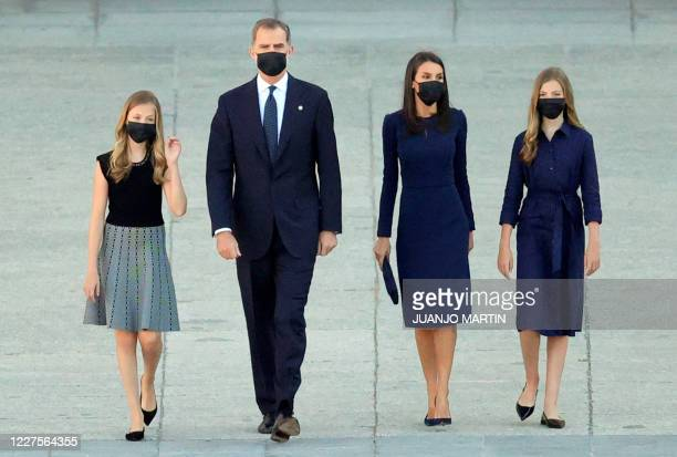 Spanish royal family members ) Crown Princess Leonor, King Felipe VI, Queen Letizia and Princess Sofia arrive to attend a state ceremony to honour...