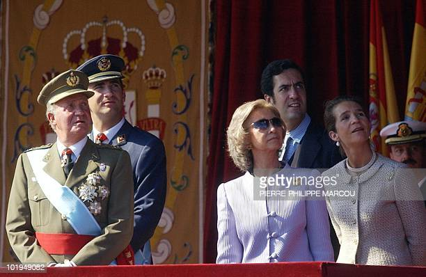 Spanish royal family's King Juan Carlos Prince Felipe Queen Sofia Jaime de Marichalar and Infanta Elena watch a parade of planes during the National...