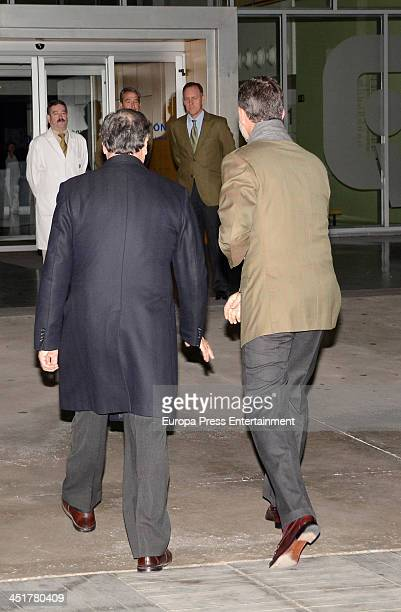 Spanish Royal Prince Felipe of Spain and Javier Ayuso visit King Juan Carlos of Spain at the Quiron University Hospital on November 24 2013 in...