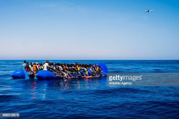 Spanish SAR plane patrols as refugees wait to get on onboard the rescue vessel Golfo Azzurro by members of the Spanish NGO Proactiva Open Arms after...