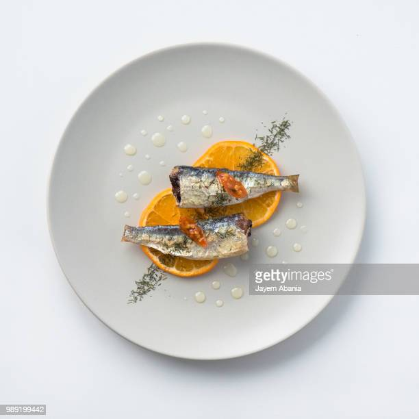 spanish sardines with mandarin slices - gourmet stock pictures, royalty-free photos & images