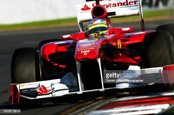 Spanish Scuderia Ferrari Formula One driver Fernando Alonso driving his Ferrari F150˚ Italia racing car during the 2011 Australian Grand Prix,...